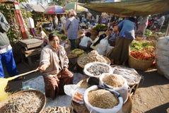 Nyaung-U Market, Myanmar. NYAUNG-U, MYANMAR - FEBRUARY 14: Unidentified woman sells dried fish on February 14, 2011 at the Nyaung-U market, Myanmar. Nyaung-U is Royalty Free Stock Photo