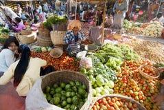 Nyaung-U Market, Myanmar. NYAUNG-U, MYANMAR - FEBRUARY 14: Unidentified people are at the vegetable stall on February 14, 2011 at the Nyaung-U market, Myanmar Royalty Free Stock Photo