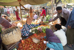 Nyaung-U Market, Myanmar. NYAUNG-U, MYANMAR - FEBRUARY 14: Unidentified people are at the vegetable stall on February 14, 2011 at the Nyaung-U market, Myanmar Royalty Free Stock Photos