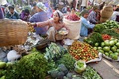 Nyaung-U Market, Myanmar. NYAUNG-U, MYANMAR - FEBRUARY 14: Unidentified  people are at the vegetable stall on February 14, 2011 at the Nyaung-U market, Myanmar Stock Images