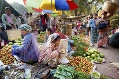 Nyaung-U Market, Myanmar. NYAUNG-U, MYANMAR - FEBRUARY 14: Unidentified  people are at the vegetable stall on February 14, 2011 at the Nyaung-U market, Myanmar Royalty Free Stock Images