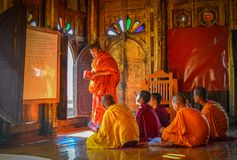 Novice monks studying at the monastery stock image