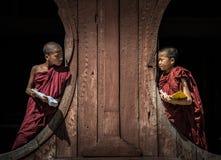 NYAUNGSHWE, MYANMAR - OCT 05 2014: Myanmar novice in the Shwe-Yaunghwe monastery the big window temple in Myanmar. Royalty Free Stock Photo