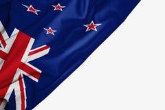Nyazeeländsk flagga av tyg med copyspace för din text på vit bakgrund vektor illustrationer