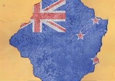 Nyazeeländskt flaggaabstrakt begrepp i hål för agg för fasadstruktur stort skadat arkivfoton
