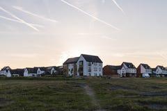 Nybyggda hus på Waverley det bostads- godset på solnedgången arkivbilder