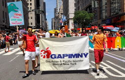 NYC: 2012 Gay Pride Parade. The Gay Asian & Pacific Islander Men of New York group marching in the 24 June 2012 Heritage of Pride gay parade on Fifth Avenue royalty free stock images