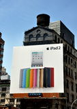 NYC: Advertising Billboard in Chinatown. A large advertising billboard for Apple's iPad2 covers the facade of a building on Canal Street in New York City's stock photography