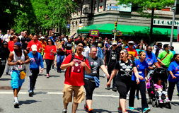 NYC: AIDS Walk 2014. NYC: Some of the 30, 000 people participating in the annual AIDS WALK NYC 2014 walkathon to raise money for AIDS charities and research royalty free stock photo