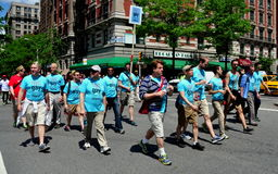 NYC: AIDS Walk 2014 Walkers. NYC: Members of the NYC Gay Men's Chorus walking in the annual AIDS WALK NYC 2014 event to raise money for AIDS charities and stock photos