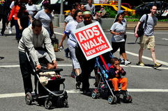 NYC: AIDS Walk 2014 Walkers. NYC: Parents with their children in strollers taking part in the annual AIDS WALK 2014 to raise money for AIDS charities stock image
