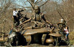 NYC: Alice in Wonderland Statue. Children love to climb and play on the imaginative and fanciful Alice in Wonderland statue in New York City's Central Park Royalty Free Stock Image