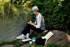 NYC: Artist painting in Central Park Stock Image