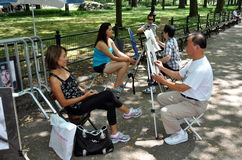 NYC: Asian Artists in Central Park Royalty Free Stock Image