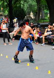 NYC: Asian Man Rollerblading in Central Park Royalty Free Stock Photos