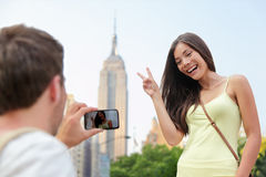 NYC asian tourist posing at Empire State Building Royalty Free Stock Image