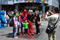 NYC: Asian Tourists Posing with Comic Book Characters Royalty Free Stock Images