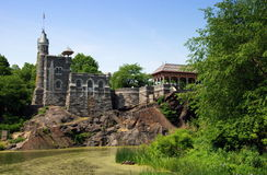 NYC: Belvedere Castle in Central Park. View across Turtle Pond to the charming little Belvedere Castle, built atop a rocky cliff affording a fine view across stock image