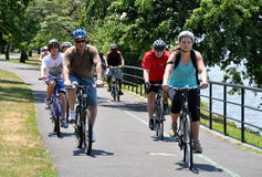 NYC: Bikers in Riverside Park. A group of bikers wearing protective helmets enjoying a summer Sunday ride along the Riverside North bike path next to the Hudson Stock Photos