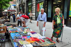 NYC: Book Vendor Selling on Broadway Royalty Free Stock Photo