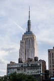 NYC Building. Empire State building seen from broadway street av Stock Photos