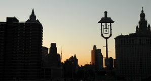 NYC buildings at sunset. New York City buildings silhouetted against sky at sunset Royalty Free Stock Photo