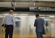 NYC Business Men Waiting for the Train on Subway Platform MTA New York City Work Commute royalty free stock images