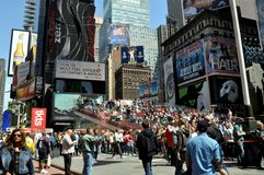 NYC: Bustling Times Square. Bustling Times Square with the TKTS booth and the new viewing stairs overlooking Father Duffy Square with advertising billboards stock photos