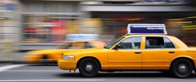 Nyc cab driving through traffic. Cab speeding through traffic in manhatan Stock Photo