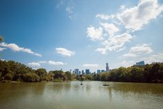 NYC Central Park lake skyline reflection up Royalty Free Stock Image
