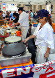 NYC: Chefs making Crêpes at Festival Stock Image