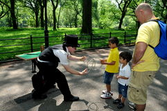 NYC: Children Watching a Magician Royalty Free Stock Images