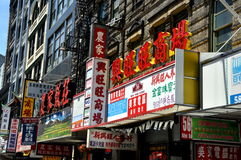 NYC:  Chinatown Mélange of Shop Signs Stock Images