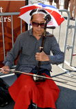 NYC: Chinese Musician Playing Erhu Stock Photography
