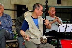 NYC: Chinese Musicians Performing in Park Royalty Free Stock Photo