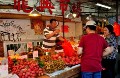 NYC: Chinese Shopping for Produce in Chinatown Stock Image