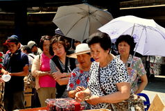 NYC: Chinese Women Buying Produce Royalty Free Stock Photography