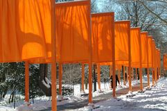 NYC: Christo's The Gates Art Installation. Famed artist Christo's landmarked art installation entitled The Gates lines a pathway in a snowy Central Park in NYC royalty free stock image