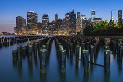 NYC Cityscape during the Evening Blue Hour. Near Night-time view of the Lower Manhattan buildings as seen from across the East River in Brooklyn during the Blue Royalty Free Stock Photos