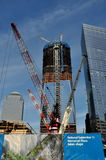 NYC: Construction at Ground Zero. Giant cranes dominate the National September 11 Memorial Plaza at Ground Zero where construction of the new One World Trade royalty free stock photography