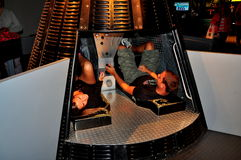NYC: Couple in Mercury Space Capsule at Intrepid Museum Royalty Free Stock Image