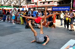 NYC:  Couple Performing Acrobatics in Times Square Royalty Free Stock Photos