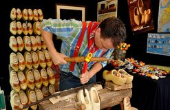 NYC: Craftsman Making Wooden Shoes. A craftsman demonstrates his skill and artistry making a pair of wooden shoes (known as klompen in Dutch) at the New Stock Photography