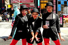 NYC:  Dancers from Musical CHICAGO in Times Square. Dancers from the hit Broadway musical CHICAGO handing out brochures to passerby in NYC's Times Square strike Stock Photography