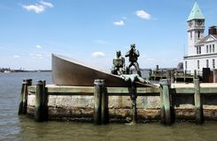 American Merchant Mariners Memorial. The American Merchant Mariners Memorial in the Battery, New York, depicts a man in the water trying to get hold of an royalty free stock images