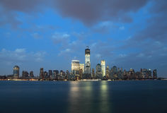 NYC Downtown and Freedom Tower at dusk. Stock Photos