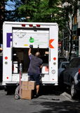 NYC: FEDEX Delivery Man and Truck Stock Images