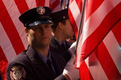 NYC Firefighter. New York firefighter carrying the American flag marching on 5th Avenue on March 17th, 2009, during St. Patrick's parade Stock Image
