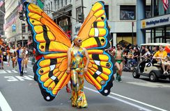 NYC: Gay Pride Parade. Man wearing an original butterfly costume as he marches in the 40th anniversary Heritage of Gay Pride parade on NYC's famed Fifth Avenue royalty free stock image
