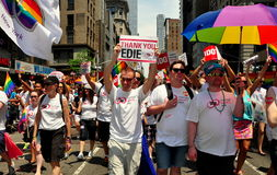 NYC: Gay Pride Parade Marchers. Gays for marriage equaity holding signs thanking Edie Windsor for suing the U. S. government to overturn DOMA marching in the Stock Image